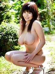 Yui Serizawa posing her large natural tits outdoors
