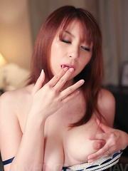Araki Hitomi Asian sucks vibrator and gets sperm on her boobies