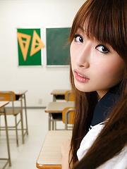 Mana Aoki posing in school class